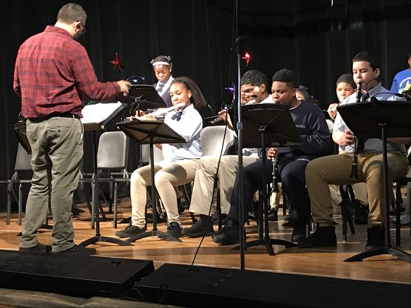 Mr. P. performs with the seventh grades at the day assembly concert.